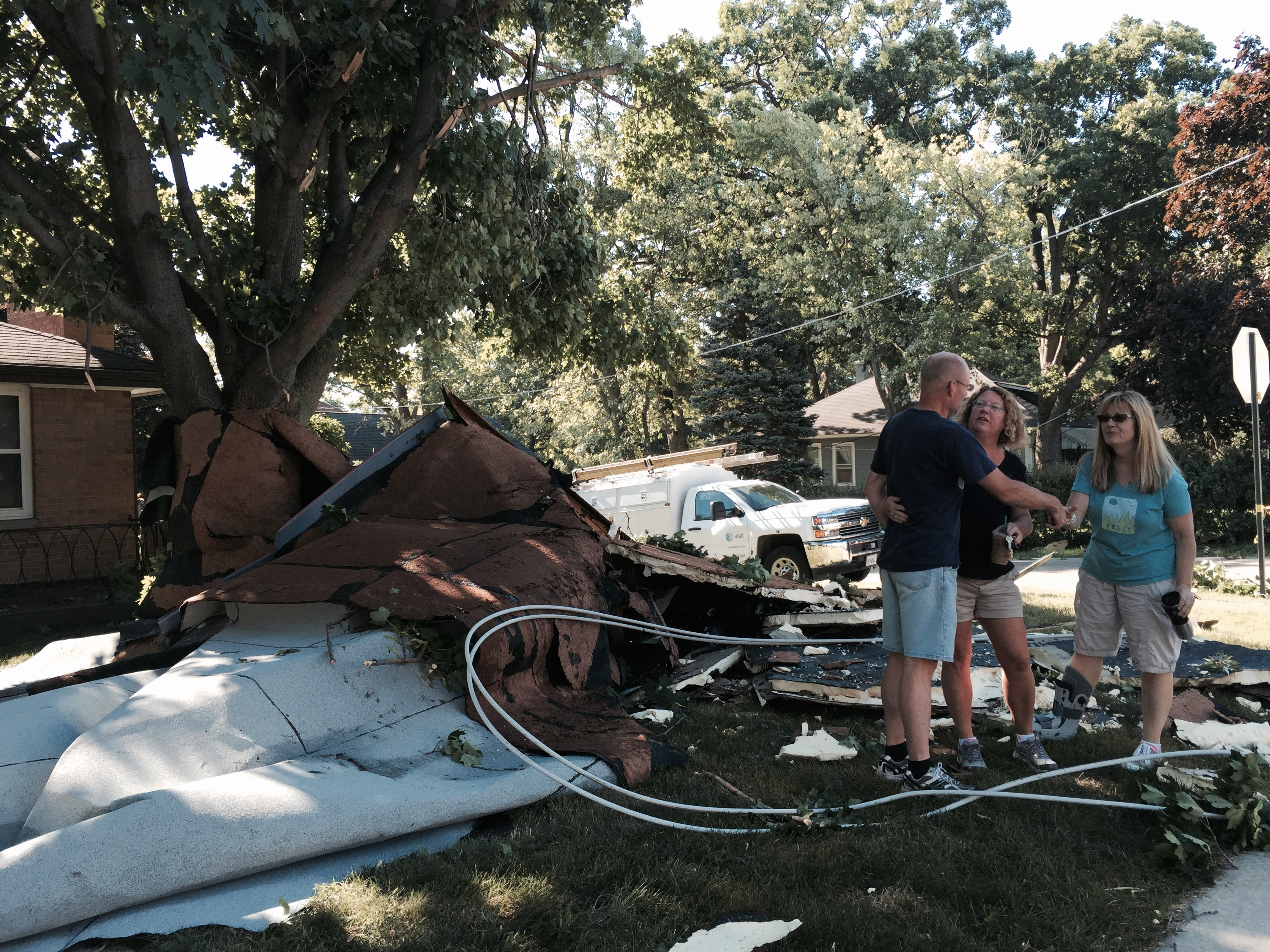 Senator Bush speaks with neighbors as they survey storm damage
